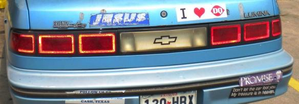 "Bumper stickers on a car ""I heart DQ"" ""Jesus is the answer"""