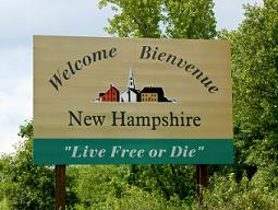 "Welcome to New Hampshire road sign the sign says, ""Welcome Bienvenue New Hampshire"" with the state motto, ""Live Free or Die""."