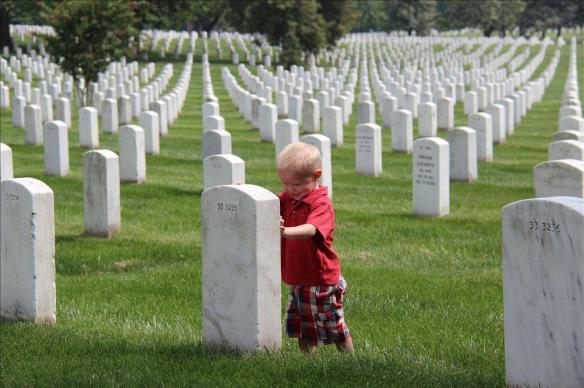 child at grave marker